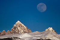 Full Moon Over Grand Tetons on winter evening