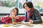 Mother and daughter - mom watches and helps daughter with her art project