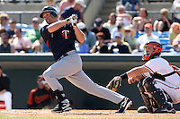 March 8, 2010:  Outfielder Michael Cuddyer of the Minnesota Twins during a Spring Training game at Ed Smith Stadium in Sarasota, FL.  Catchr Craig Tatum of the Baltmimore Orioles.  Photo By Mike Janes/Four Seam Images