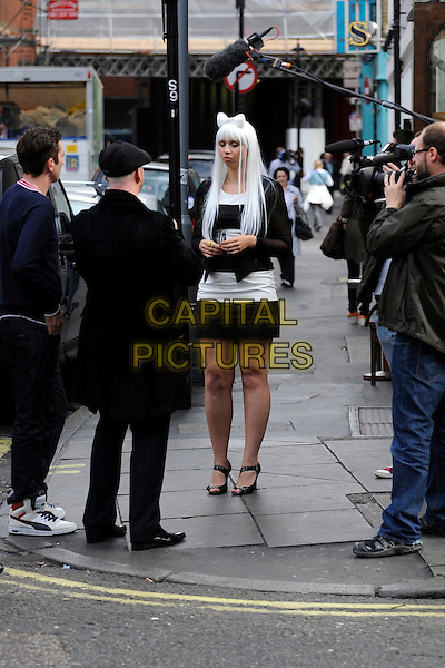 ATMOSPHERE .Filming on the set of the Sky TV reality programme 'Bigger Than Britney', London, England..11th October 2011.** EXCLUSIVE ALL-ROUNDER**.behind the scenes lookalike lady gaga cast crew black white skirt gv general view .CAP/IA.©Ian Allis/Capital Pictures.