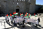 Marathon runners leave the Old City of Jerusalem during the Jerusalem Marathon, in Jerusalem, 19  March 2012. Photo by Mahfouz Abu Turk