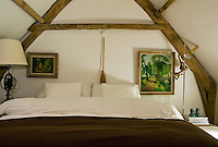 This bedroom under the eaves is filled by the large double bed