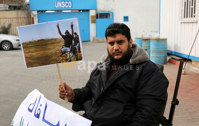 "Disabled Palestinians take part in a protest against the killing of Ibraheem Abu Thuraya in front of the headquarter United Nation ""UNESCO"", in Gaza City, on December 21, 2017. Abu Thuraya, who was shot dead by Israeli security forces during clashes near the border with Israel in the east of Gaza City against U.S. President Donald Trump's decision to recognize Jerusalem as the capital of Israel. Photo by Ashraf Amra"