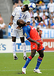July 4, 2009: Honduras's Carlos Palacios, left, gets up over Haiti's Leonal Saint Preux during the Group B soccer match of the CONCACAF Gold Cup held at Quest Field in Seattle, Wash. Honduras would go onto win the match with a final score of 1-0.