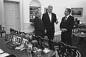 Washington, D.C. - December 15, 1999 -- United States President Bill Clinton meets with Prime Minister Ehud Barak of Israel and Foreign Minister Farouk al-Shara of Syria in the Oval Office, The White House, December 15, 1999. From Left to Right: Minister Farouk al-Sharaa, Foreign Minister of Syria; THE PRESIDENT; Prime Minister Ehud Barak, Prime Minister of Israel..Credit: Sharon Farmer - White House via CNP