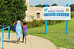 East Meadow, New York, U.S. 15th July 2013. The Nassau County Aquatic Center at Eisenhower Park has close to a steady stream of people coming to the pool, as the National Weather Service extends its Heat Advisory to all of Long Island, New York. Temperatures in the 90's Fahrenheit (over 32 degrees Celsius) spread throughout Eastern U.S., and the dangerously hot humid weather threatens to last the entire week.