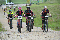 NWA Democrat-Gazette/J.T. WAMPLER  A group of Cat 3 riders climbs a hill Sunday August 11, 2019 during the Kessler Mountain Jam in Fayetteville. The annual event is sponsored by Fayetteville Parks and Recreation and is part of the Arkansas Mountain Bike Championship Series.