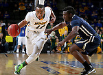 SIOUX FALLS, SD - MARCH 9: Lawrence Alexander #12 of NDSU drives defender #3 of Oral Roberts in the first half of their semi-final round Summit League Championship Tournament game Monday evening at the Denny Sanford Premier Center in Sioux Falls, SD. (Photo by Dave Eggen/Inertia)