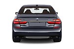 Straight rear view of a 2018 BMW 7 Series M Sport 4 Door Sedan stock images