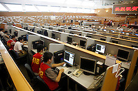 Stock traders work on the trading floor of the Shanghai Stock Exchange (SSE) in Shanghai, China. The Shanghai Stock Exchange is one of the three stock exchanges operating independently in the People's Republic of China, the other two are the Shenzhen Stock Exchange and the Hong Kong Stock Exchange. It is the world's sixth largest stock market by market capitalization at US$2.4 trillion as of Aug 2010..18 Aug 2010
