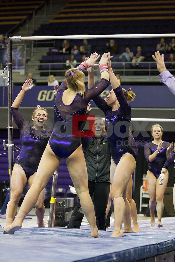 The University of Washington gymnastics team hosts a meet against Oregon State and Seattle Pacific at Alaska Airlines Arena on Friday, March 14, 2014 (Photo by Max Waugh/Red Box Pictures)