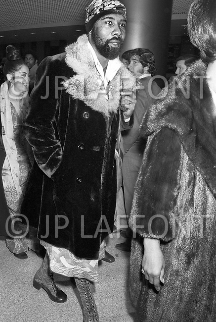 Manhattan, New York City, NY - March 8, 1971  <br /> Muhammad Ali and Joe Frazier at Madison Square Garden  - Billed as the &lsquo;Fight of the Century&rsquo; African-American boxing fans and dandies attended wearing the most glam-fashions of the day. Furs, minis and thigh-high platform boots were all the rage.