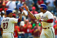 Philadelphia Phillies outfielder Hunter Pence #3 is greeted by teammate Placido Polanco #27 after his home run during the Major League Baseball game against the Pittsburgh Pirates on June 28, 2012 at Citizens Bank Park in Philadelphia, Pennsylvania. The Pirates defeated the Phillies 5-4. (Andrew Woolley/Four Seam Images).