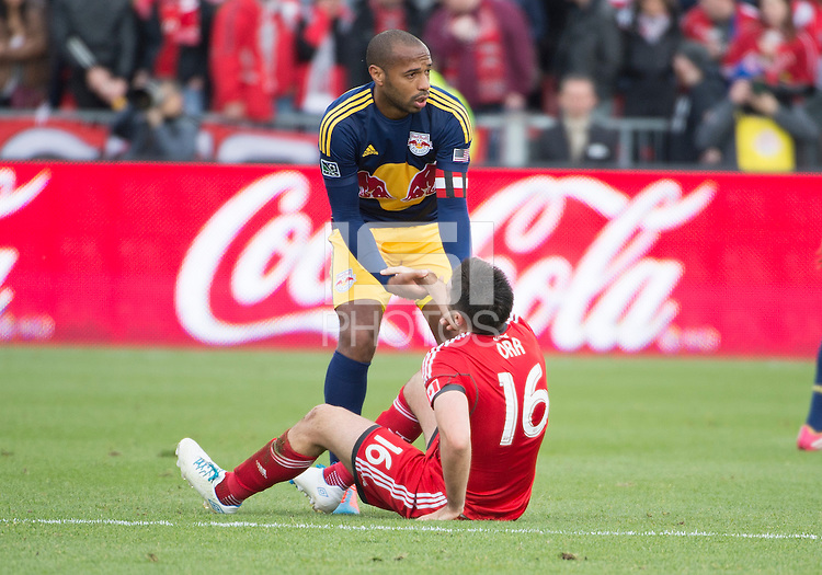 Toronto, Ontario - May 17, 2014: New York Red Bulls forward Thierry Henry #14 helps up Toronto FC defender Bradley Orr #16 during a game between the New York Red Bulls and Toronto FC at BMO Field. Toronto FC won 2-0.