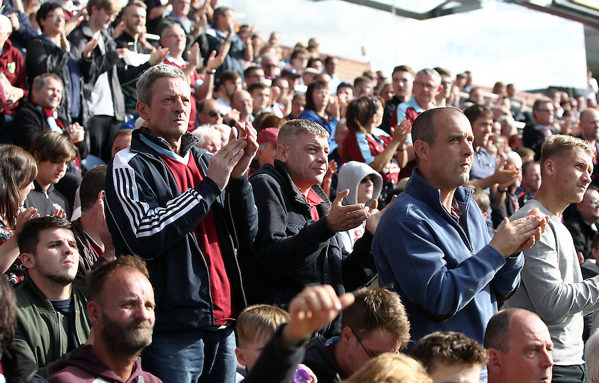 Burnley fans applaud at 50 minutes into the game<br /> <br /> Photographer Rich Linley/CameraSport<br /> <br /> The Premier League - Burnley v Hull City - Saturday 10th September 2016 - Turf Moor - Burnley<br /> <br /> World Copyright &copy; 2016 CameraSport. All rights reserved. 43 Linden Ave. Countesthorpe. Leicester. England. LE8 5PG - Tel: +44 (0) 116 277 4147 - admin@camerasport.com - www.camerasport.com