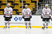 Drew Daniels (NU - 24), Mike Hewkin (NU - 28), Dylan Wiwchar (NU - 32) - The Northeastern University Huskies defeated the Harvard University Crimson 4-1 (EN) on Monday, February 8, 2010, at the TD Garden in Boston, Massachusetts, in the 2010 Beanpot consolation game.