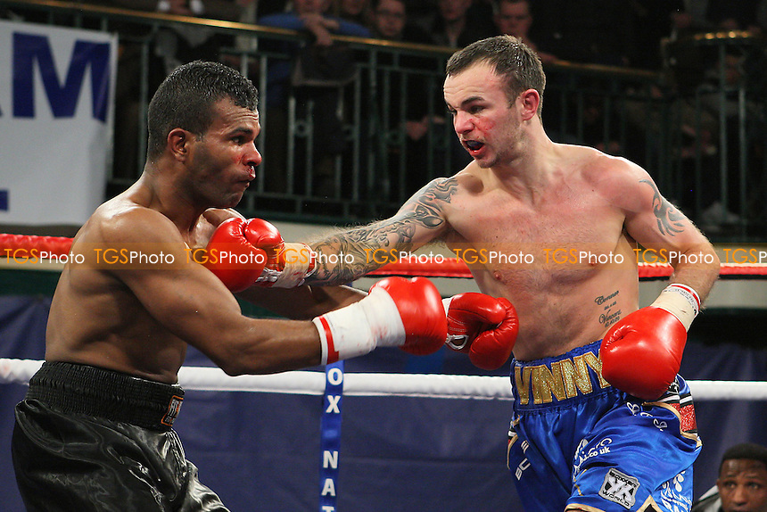 Kevin Mitchell (blue shorts) defeats Felix Lora in a Lightweight boxing contest at York Hall, Bethnal Green, promoted by Frank Warren - 10/02/12 - MANDATORY CREDIT: Gavin Ellis/TGSPHOTO - Self billing applies where appropriate - 0845 094 6026 - contact@tgsphoto.co.uk - NO UNPAID USE.