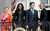 United States President Barack Obama, right, First Lady Michelle Obama, left center, and Prime Minister Justin Trudeau of Canada, right center, and and Mrs. Sophie Gr&eacute;goire Trudeau, left, wave from the South Portico of the White House following an Arrival Ceremony in Washington, DC on Thursday, March 10, 2016. <br /> Credit: Olivier Douliery / Pool via CNP