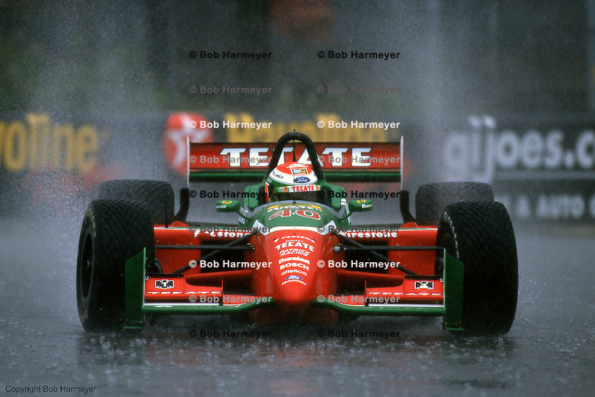 Adrian Fernandez drives a Reynard-Ford in heavy rain,during the 1999 CART Indycar race at Portland International Raceway in Portland, Oregon.