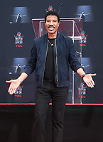 HOLLYWOOD, CA - MARCH 7: Lionel Richie pictured at Lionel Richie's TCL Hand And Footprints Ceremony At The TCL Chinese Theatre IMAX In Hollywood, California on March 7, 2018. <br /> CAP/MPI/FS<br /> &copy;FS/MPI/Capital Pictures