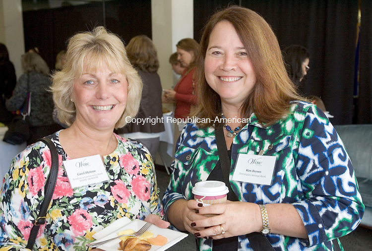 TORRINGTON CT. 26 September 2014-092614SV13-From left, Carol Monroe of New Hartford, Northwest Community Bank, and Kim Brown of Torrington, Torrington Savings Bank, attend the 10th annual Northwest Connecticut Chamber's women's professional development forum in Torrington Friday.<br /> Steven Valenti Republican-American