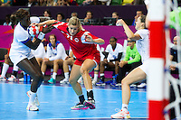 28 JUL 2012 - LONDON, GBR - Gøril Snorroeggen (NOR) of Norway (second from left in red) finds her path to goal blocked by Claudine Mendy (FRA) of France (left) during their women's London 2012 Olympic Games Preliminary round handball match at The Copper Box in the Olympic Park, in Stratford, London, Great Britain .(PHOTO (C) 2012 NIGEL FARROW)