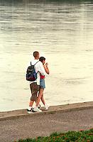 Couple age 14 walking down by the Vistula River lovingly.  Torun Poland