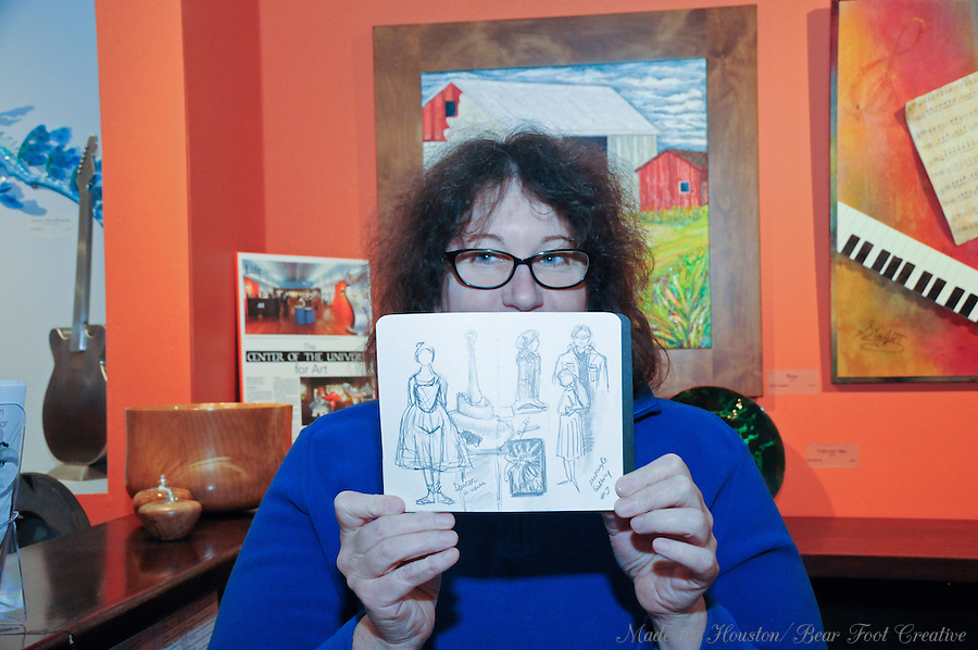 Artist Sara Light-Waller shows work created during the urban sketch crawl at the Rectangle Gallery during Centralia, Washington's Third Thursday on October 20, 2016.