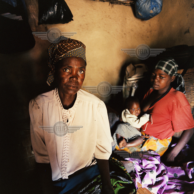 Lomi (right) sits with her mother Magundo and her seven month old baby. All three of them are HIV positive, and Lomi is currently receiving ARVT (Antiretroviral Treatment). Her husband died of AIDS in 2002....