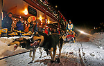 Jackson,Wyoming--1/27/06--7:13:15 PM-.Musher Dan Carter, 35, of Jackson, WYO, races with his dogs along Broadway at the start of the race...<br />