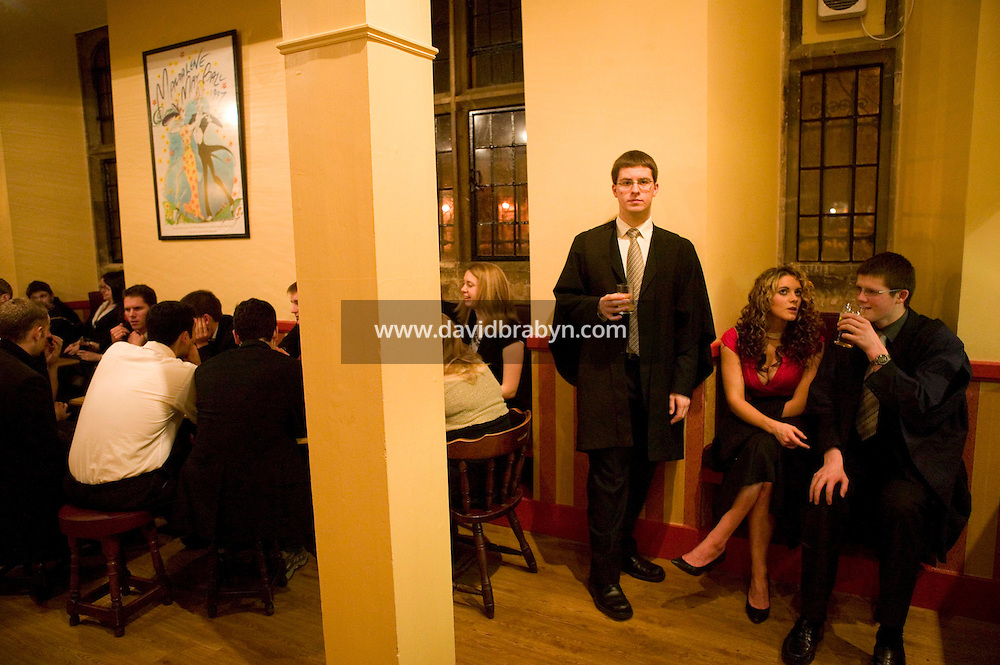 Students gather for drinks in the college bar after formal dinner at Magdalene College in Cambridge, United Kingdom, 11 March 2007.