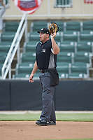 Home plate umpire Bryan Van Vranken works the plate during the South Atlantic League game between the Hagerstown Suns and the Kannapolis Intimidators at Kannapolis Intimidators Stadium on August 26, 2019 in Kannapolis, North Carolina. The Suns defeated the Intimidators 4-1. (Brian Westerholt/Four Seam Images)