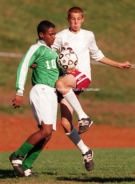 NAUGATUCK, CT.--9/29/98--0929MA03.tif--Vladimir Mariano, left of Wilby gets tangles up with B.J. Kochis of Naugatuck during soccer action Tuesday afternoon at Naugatuck High School. MICHAEL ASARO staff photo for Sports