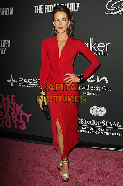 Kate Beckinsale<br /> The Pink Party 2013 held at the Santa Monica Airport, Santa Monica, California, USA.<br /> October 19th, 2013<br /> full length dress red black clutch bag  wrap slit split hand on hip <br /> CAP/ADM/KB<br /> &copy;Kevan Brooks/AdMedia/Capital Pictures