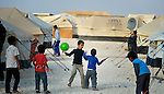 Children playing in the Zaatari Refugee Camp, located near Mafraq, Jordan. Opened in July, 2012, the camp holds upwards of 50,000 refugees from the civil war inside Syria. International Orthodox Christian Charities and other members of the ACT Alliance are active in the camp providing essential items and services.