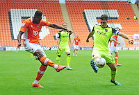 Blackpool's Jamille Matt crosses the ball despite the attentions of Exeter City's Jordan Moore-Taylor<br /> <br /> Photographer Kevin Barnes/CameraSport<br /> <br /> Football - The EFL Sky Bet League Two - Blackpool v Exeter City - Saturday 6th August 2016 - Bloomfield Road - Blackpool<br /> <br /> World Copyright &copy; 2016 CameraSport. All rights reserved. 43 Linden Ave. Countesthorpe. Leicester. England. LE8 5PG - Tel: +44 (0) 116 277 4147 - admin@camerasport.com - www.camerasport.com