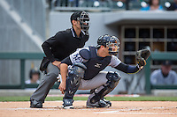 Scranton\Wilkes-Barre RailRiders catcher Austin Romine (7) sets a target as home plate umpire Joey Amaral looks on during the game against the Charlotte Knights at BB&T BallPark on May 1, 2015 in Charlotte, North Carolina.  The RailRiders defeated the Knights 5-4.  (Brian Westerholt/Four Seam Images)
