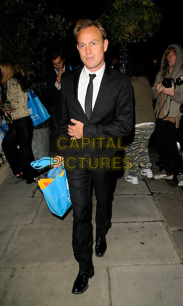 "JASON DONOVAN .Attending Kathy Lette's ""To Love, Honour and Betray"" book launch party, London, England. .September 24th 2008.full length black suit blue bag .CAP/CAN.©Can Nguyen/Capital Pictures."