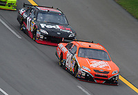 Apr 27, 2008; Talladega, AL, USA; NASCAR Sprint Cup Series driver Tony Stewart (20) leads teammate Denny Hamlin (11) during the Aarons 499 at Talladega Superspeedway. Mandatory Credit: Mark J. Rebilas-