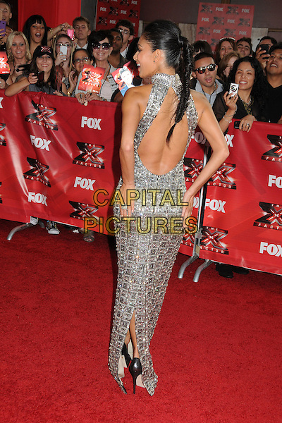 "Nicole Scherzinger.""The X Factor"" World Premiere Screening Event held at the Cinerama Dome, Hollywood, California, USA..September 14th, 2011.full length grey gray silver sleeveless beads beaded sequins sequined dress backless back behind rear looking over shoulder fishtail plait braid hair hands touching bum.CAP/ADM/BP.©Byron Purvis/AdMedia/Capital Pictures."