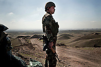 Peshmerga soldiers on the frontline in Kirkuk looking out towards Iraqi army positions in the valley below.