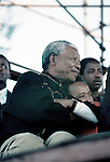 DURBAN, SOUTH AFRICA - APRIL 13: Nelson Mandela waits to hold a speech on April 13, 1994 in Durban, South Africa. The pre-election rally was just weeks before the historic democratic election on April 27, 1994 that Mr. Mandela won. Mr. Mandela became the first black democratic elected president in South Africa. He retired from office after one term in June 1999. (Photo by Per-Anders Pettersson).