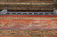 Section of the painted decorative balcony of the Prayer hall of the Helveti Tekke or Teqe e Helvetive, a Bektashi Sufi shrine of the Helveti sect built in the 15th century and rebuilt by Ahmet Kurt Pasha in 1782, with mihrab on the far wall, in Berat, South-Central Albania, capital of the District of Berat and the County of Berat. The ceiling is decorated in the Baroque style adopted by Islamic art and 14 carat gold has been used. The tekke is composed of a square prayer hall, an external portico (with columns from Appolonia) and a room which housed the mausoleum of Ahmet Kurt Pasha and his son. On the inner walls are 8 frescoes of houses, muslim religious buildings and gardens. Picture by Manuel Cohen