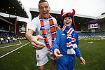 Lee McCulloch's wee boy steals my camera and takes this picture of his dad and elder brother enjoying the celebrations on the pitch.