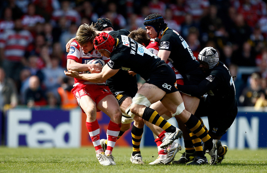 Photo: Richard Lane/Richard Lane Photography. London Wasps v Gloucester Rugby. Amlin Challenge Cup Quarter Final. 11/04/2010. Gloucester's Freddie Burns is tackled by Gloucester's Dan Ward-Smith.