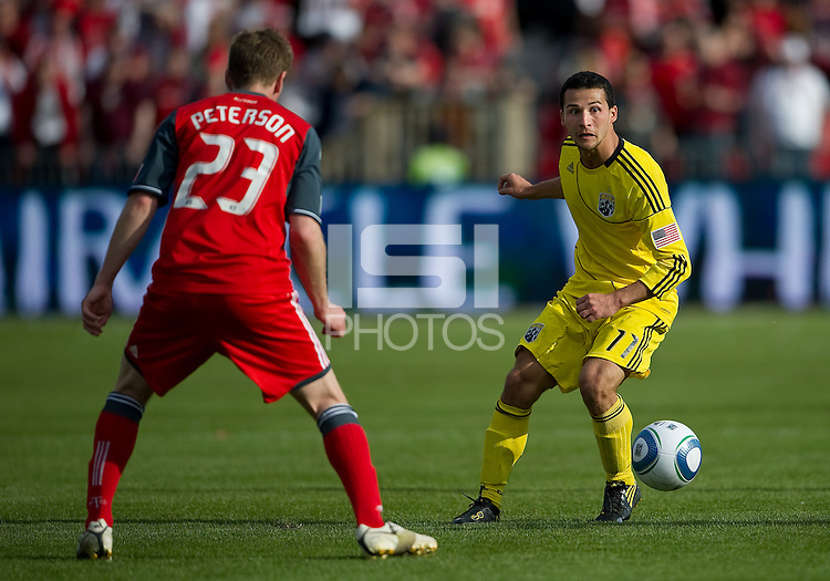 23 April 2011: Columbus Crew midfielder Dilly Duka #11 and Toronto FC midfielder Jacob Peterson #23 in action during a game between the Columbus Crew and the Toronto FC at BMO Field in Toronto, Ontario Canada..The game ended in a 1-1 draw.