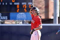 GREENSBORO, NC - FEBRUARY 22: Sam Merino #19 salutes her teammates on the bench after getting a hit during a game between Fairfield and North Carolina at UNCG Softball Stadium on February 22, 2020 in Greensboro, North Carolina.
