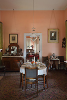 Dining room of the Commanding Officer's quarters, on Officers' Row, at Fort Davis National Historic Site, a US army fort established 1854, in a canyon in the Davis Mountains in West Texas, USA. The house was begun in 1867 under Lieutenant Colonel Wesley Meritt, but has been refurbished to the time of Colonel Benjamin Grierson, commander of the black Tenth US Cavalry, and his family, who lived here 1882-85. The fort was built to protect emigrants, mail coaches, and freight wagons on the trails through the State from Comanche and Apache Indians. After the Civil War, several African-American regiments were stationed here. By the 1880s, the fort consisted of one 100 buildings, housing over 400 soldiers. It was abandoned in 1891, but many buildings have been restored and the compound now operates as a historical site and museum. Picture by Manuel Cohen