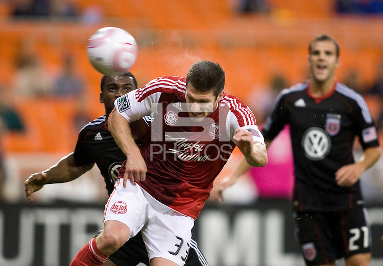 Kenny Cooper (33) of the Portland Timbers scores on a header during the game at RFK Stadium in Washington, D.C. D.C. United tied the Portland Timbers, 1-1.