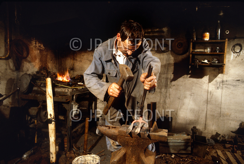 Poland, September, 1981 - A blacksmith at work in the Torun region.